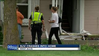 Car crashes into West Allis home after colliding with another vehicle - Video