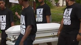 Men carrying caskets march through the streets of East Cleveland - Video