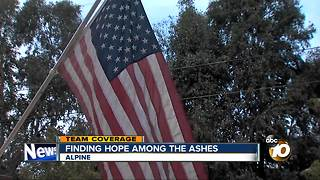 Amid chaos of the West Fire, neighbor saves American flag - Video