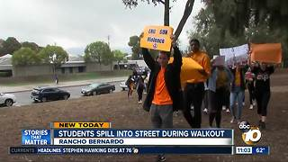 Students spill into street during walkout - Video