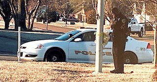 School Resource Officer Prays At Flagpole