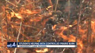 University Lake School students help with controlled prairie burn - Video