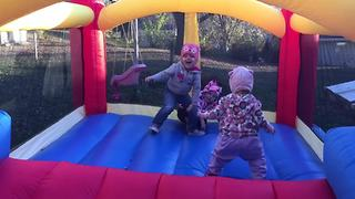 A Tot Girl Falls Out Of A Bounce House - Video