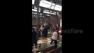 Fans throw benches as fight breaks out between Polish and Senegalese supporters - Video