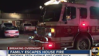 Family escapes Phoenix house fire - Video