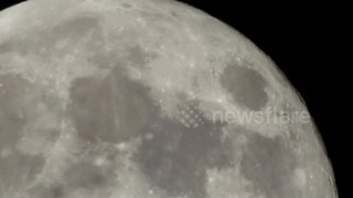 Amateur gets lucky with extreme closeup of supermoon - Video