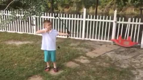 Kid pulls out his first tooth in most epic way possible!