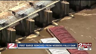 First barge removed from Webbers Falls dam