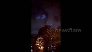 Mysterious blue lights move in flying wheel formation over Moscow - Video