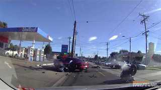 Two Motorcyclists Collide With Sedan in Melbourne Suburb - Video