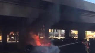 Person arrested for allegedly setting fire to car at Las Vegas Fire & Rescue Department headquarters - Video