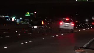Car slams into truck stalled on I-8 - Video