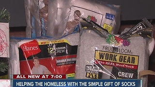 Helping the homeless with the simple gift of socks - Video