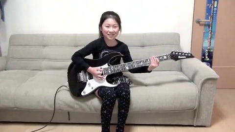 Cool girl playing electric guitar