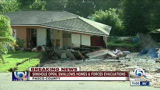 Sinkhole swallows 2 homes in Pasco County - Video