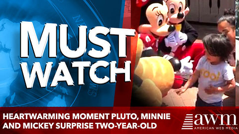 Heartwarming moment Pluto, Minnie and Mickey surprise two-year-old