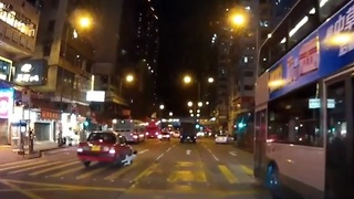 Little Girl Hit by Taxi After Running Into Busy Hong Kong Traffic - Video