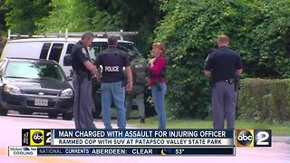 Man suspected of trying to ram police officer surrenders - Video