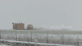 Snow ploughs clear Leeds Bradford Airport - Video