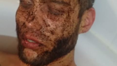 Guy ironically falls asleep with coffee on his face in the tub