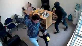 Fearless Six-Year-Old Girl Tries to Stop Axe-Wielding Robber in Her Family Store - Video