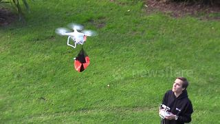 Dad uses drone to launch toy parachute - Video