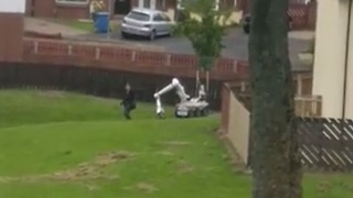 Woman Left 'Shaken' After Walking Past Police Robot Carrying Out Controlled Explosion - Video