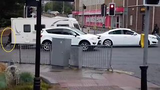Cyclist 'bumped off' bike by driver gets revenge by pulling up caravan's handbrake at traffic lights - Video