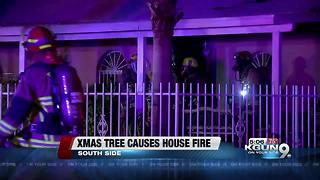Christmas tree fire destroys home and displaces family - Video