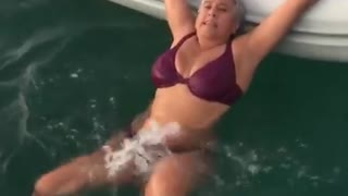 Lady Shows A Simple And Effortless Way To Get Into A Dingy If You Are Stuck In The Water. - Video