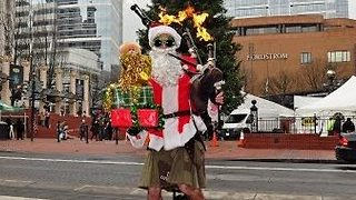 It Just Isn't Christmas Until You See a Flaming Bagpipe-Playing Santa on a Unicycle - Video