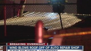 Roof blows off auto repair shop, causes outages