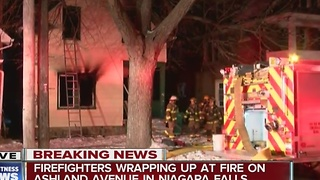 Niagara Falls firefighters work early morning house fire - Video