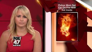 Mother faces charges for setting car ablaze with son inside - Video