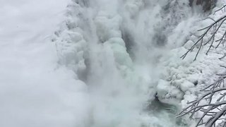Quechee Gorge Waterfall Freezes in Sub-Zero Temperatures - Video