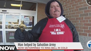 Man helped by Salvation army determined to ring bell through the cold - Video