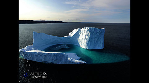 Majestic drone footage captures iceberg with a lagoon
