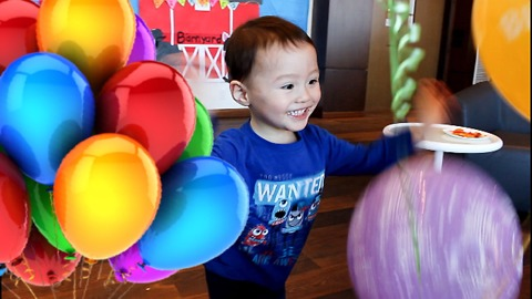 Toddler is SUPER EXCITED over Birthday Balloons!