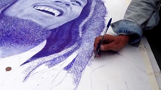 Artist creates realistic Bob Marley pen portrait - Video