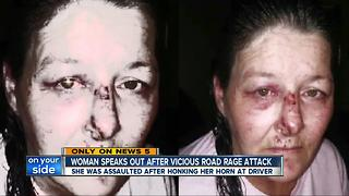 Akron woman left bloodied and bruised after alleged road rage incident - Video