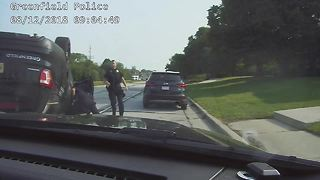 Greenfield police car rolls over during a chase - Video