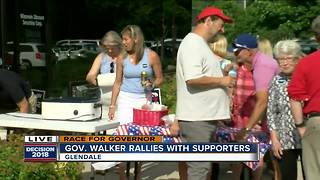 Walker rallies with supporters before Democratic debate