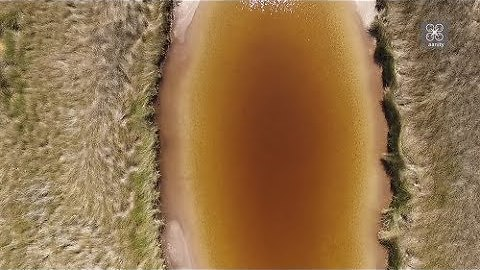 """Drone view of """"Crème caramel"""" lake and """"ink lagoon"""" near Athens, Greece"""