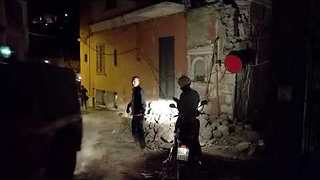 Ischia Quake Survivors Walk Over Rubble to Safety - Video
