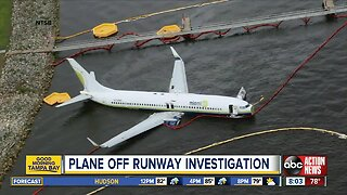 The latest: Plane skids off runway into St. Johns River