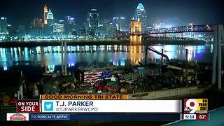 Heaping trash barge docks in Covington to help Procter and Gamble clean up Ohio River