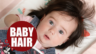 Baby born with full head of hair now boasts EIGHT INCH locks at the age of just six-months-old