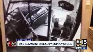 Car slams into beauty supply store - Video