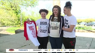 Local artist designs social distancing shirts