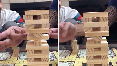 Best jenga move ever? Crafty gamer pulls off incredible Jenga move by flicking piece out